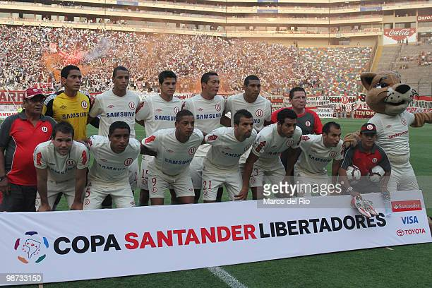 Players of Peru's Universitario de Deportes pose for a photo prior to a Libertadores Cup match against Brazil's Sao Paulo at the Monumental stadium...