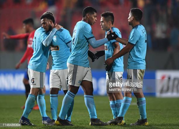Players of Peruvian team Sporting Cristal greet each other after defeating Chile's Union Espanola 30 in a Copa Sudamericana football match at the...