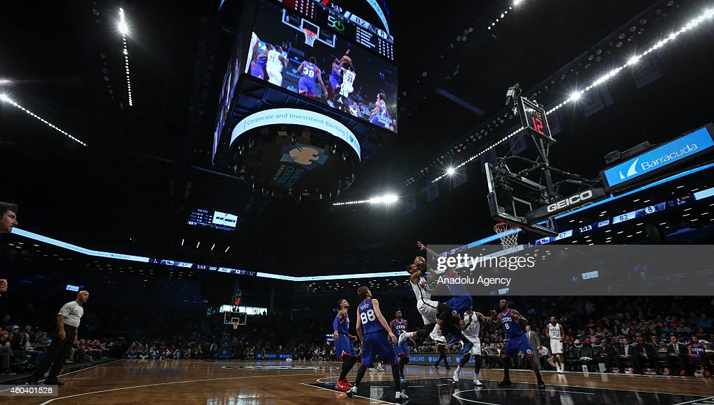 Players of Philadelphia 76ers vie with players of Brooklyn Nets during a basketball game at the Barclays Center on December 12, 2014 in the Brooklyn borough of New York, NY.