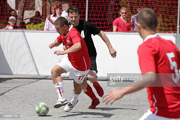 Players of Poland's homeless football team take part in a street football tournament in Cieszyn on June 11 2012 Homeless football world cup will take...