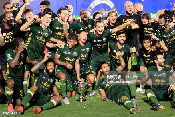 Players of Portland Timbers celebrate with the champions trophy after defeating Orlando City 2-1 in the final match of MLS Is Back Tournament at ESPN...