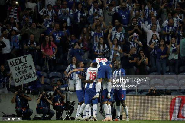 Players of Porto FC celebrate after their team mate Moussa Marega scored a goal during the UEFA Champions League Group D soccer match between Porto...