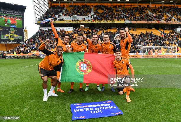 Players of Portugal and Wolverhampton Wanderers celebrate promotion to the Premier League during the Sky Bet Championship match between Wolverhampton...