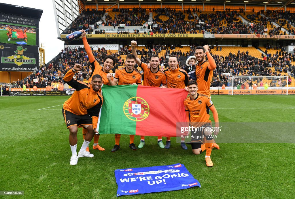Players of Portugal and Wolverhampton Wanderers celebrate promotion to the Premier League during the Sky Bet Championship match between Wolverhampton Wanderers and Birmingham City at Molineux on April 15, 2018 in Wolverhampton, England.