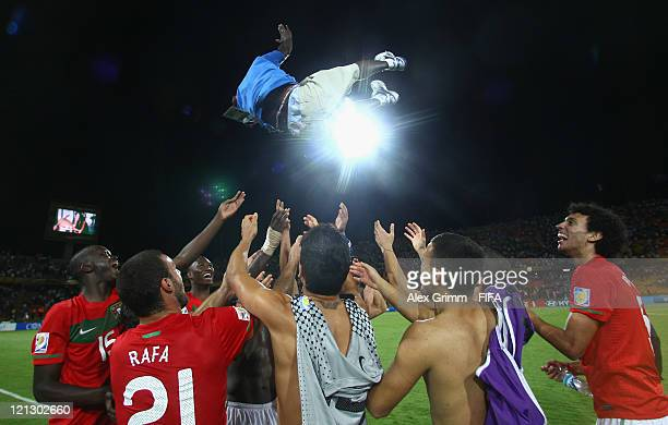 Players of Portugal celebrate by throwing teammate Sana into the air after the FIFA U-20 World Cup 2011 semi final match between France and Portugal...