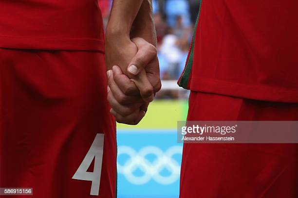 Players of Portugal holding their hands at their national anthem for the Men's Group D first round match between Honduras and Portugal during the Rio...