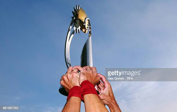 Players of Portugal lift the trophy after winning the FIFA Beach Soccer World Cup Portugal 2015 Final between Tahiti and Portugal at Espinho Stadium...