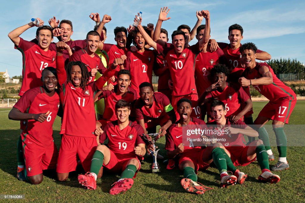 Players of Portugal U17 celebrate their victory with the cup at the end of the U17-Juniors Algarve Cup match between U17 Portugal and U17 Germany at Bela Vista Stadium on February 13, 2018 in Parchal, Portugal.