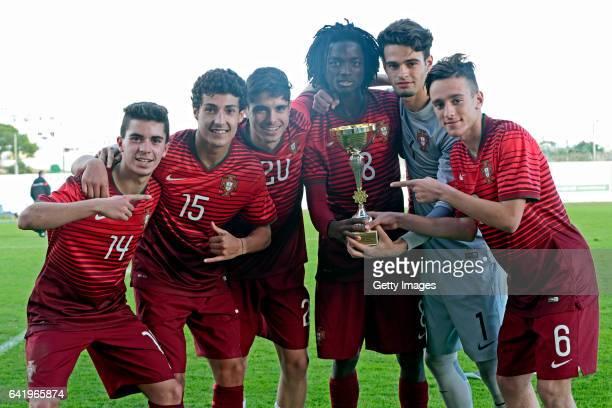 Players of Portugal U17 Vitor Ferreira João Oliveira Pedro Neto Romário Baró João Gonçalo Afonso Sousa celebrate the winning with the cup at the end...
