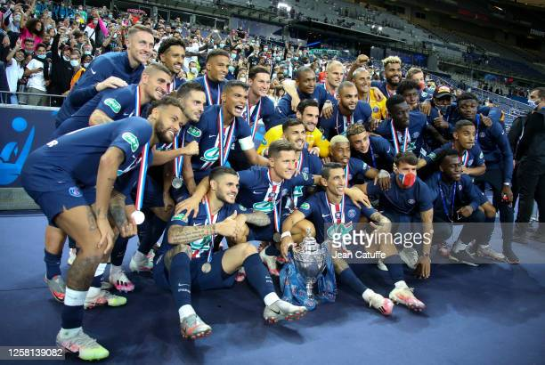 Players of PSG celebrate the victory during the trophy ceremony following the French Cup Final match between Paris Saint Germain and AS Saint Etienne...