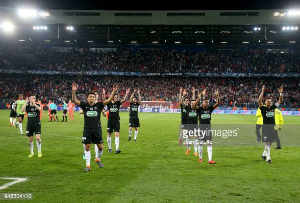 Players of PSG celebrate the victory following the French Cup semifinal between Stade Malherbe de Caen and Paris Saint Germain at Stade Michel...