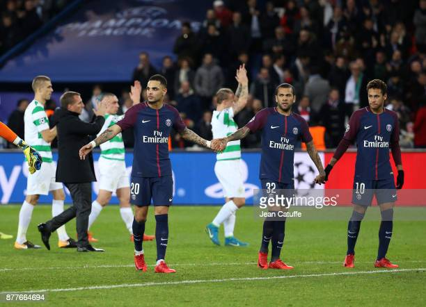 Players of PSG celebrate their large victory while players of Celtic salute their fans following the UEFA Champions League group B match between...