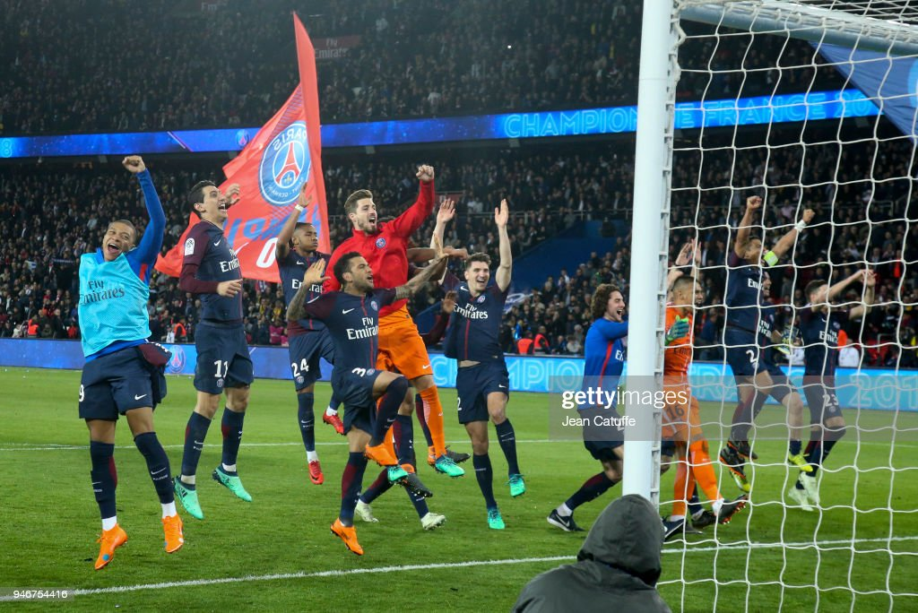 Players of PSG celebrate winning the French Championship following the Ligue 1 match between Paris Saint Germain (PSG) and AS Monaco (ASM) at Parc des Princes stadium on April 15, 2018 in Paris, .