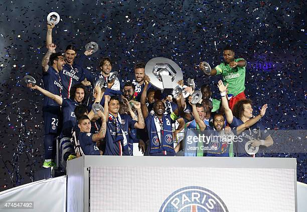 Players of PSG celebrate winning the French Ligue 1 championship 2014-2015 during the trophy ceremony following the match between Paris Saint-Germain...