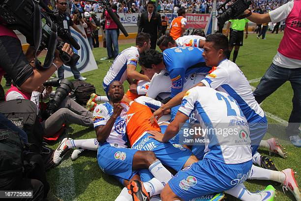 Players of Puebla celebrate a goal against Atlas during a match between Puebla and Atlas as part of the Clausura 2013 Liga MX at Cuauhtemoc Stadium...