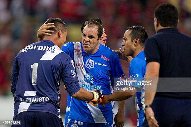 Players of Puebla celebrate after winning a Quarterfinals match between Atlas and Puebla as part of Copa MX Apertura 2014 at Jalisco Stadium on...