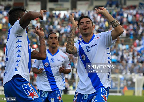Players of Puebla celebrate the first goal f the game during a match between Puebla and Tigres UANL as part of 5th round Apertura 2014 Liga MX at...