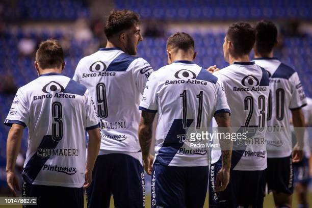Players of Puebla celebrate their first goal during the 4th round match between Puebla and Veracruz as part of the Torneo Apertura 2018 Liga MX at...
