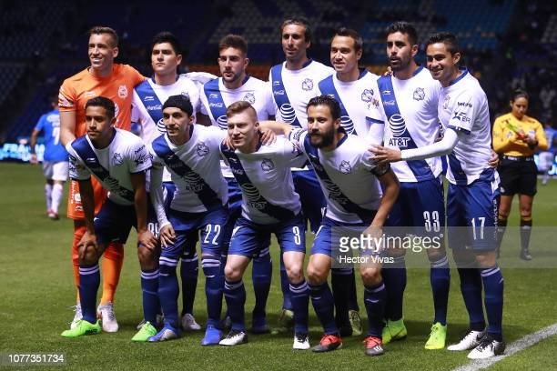 Players of Puebla pose for the team photo during the first round match between Puebla and Cruz Azul as part of the Torneo Clausura 2019 Liga MX at...
