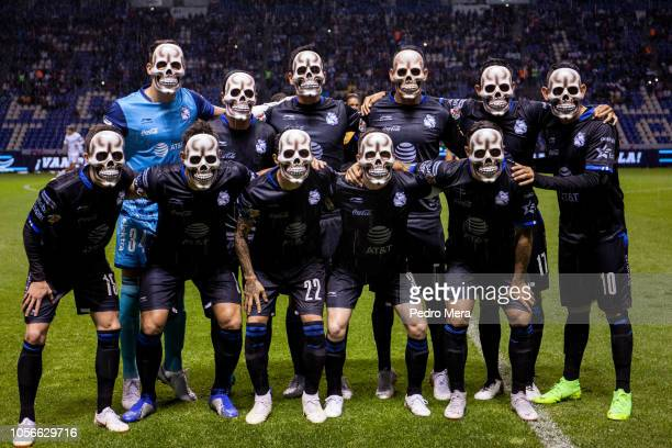 Players of Puebla pose for the team photo wearing skull masks prior the 15th round match between Puebla and Chivas as part of the Torneo Apertura...