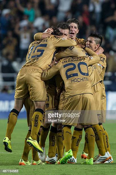 Players of Pumas celebrate a goal of their teammate Javier Cortes during the Quarterfinal first leg match between Pumas UNAM and Pachuca as part of...