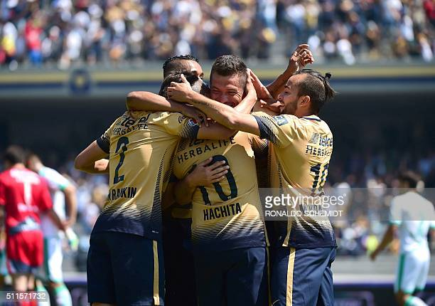 Players of Pumas celebrate after scoring against Santos during their Mexican Clausura 2016 tournament football match at the Universitario stadium on...