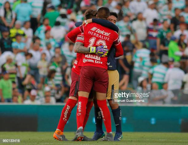 Players of Pumas celebrate after the 16th round match between Santos Laguna and Pumas UNAM as part of the Torneo Clausura 2018 Liga MX at Corona...