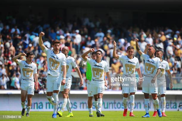 Players of Pumas celebrate after winning the seventh round match between Pumas UNAM and America as part of the Torneo Clausura 2019 Liga MX at...