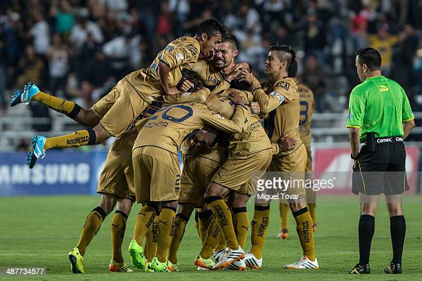 Players of Pumas celebrates a goal of his teammate Javier Cortes during the Quarterfinal first leg match between Pumas UNAM and Pachuca as part of...