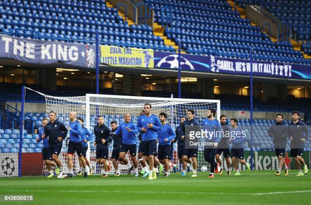 Players of Qarabag FK warm up during a Qarabag training session ahead of the UEFA Champions League Group C match against Chelsea at Stamford Bridge...