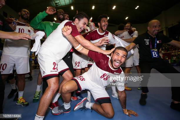 Players of Qatar celebrate after winning gold medal during Men's Handball Gold Medal Final at GOR Popki Cibubur between Qatar and Bahrain on day...
