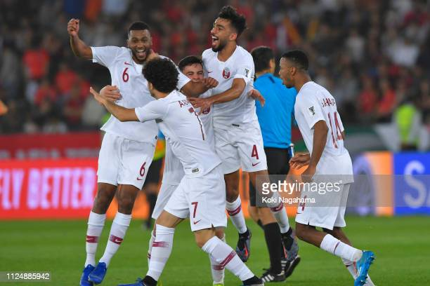 Players of Qatar celebrate after winning the AFC Asian Cup quarter final match between South Korea and Qatar at Zayed Sports City Stadium on January...