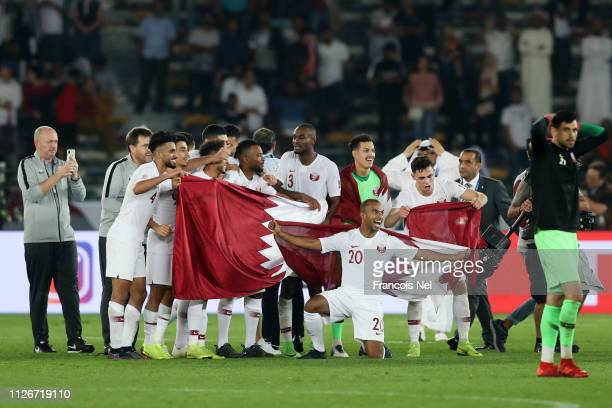 Players of Qatar celebrate following their sides victory in the AFC Asian Cup final match between Japan and Qatar at Zayed Sports City Stadium on...