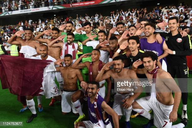 Players of Qatar celebrate the victory after the AFC Asian Cup quarter final match between South Korea and Qatar at Zayed Sports City Stadium on...