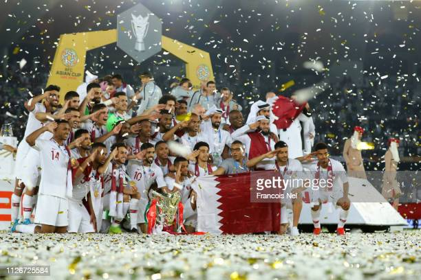 Players of Qatar celebrates with the AFC Asian Cup trophy following their victory in the AFC Asian Cup final match between Japan and Qatar at Zayed...