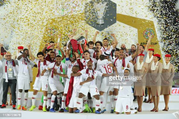Players of Qatar lifts the AFC Asian Cup trophy following their victory in the AFC Asian Cup final match between Japan and Qatar at Zayed Sports City...