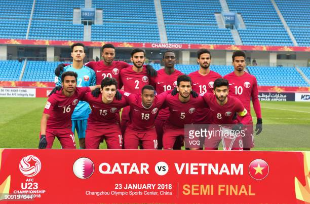 Players of Qatar line up prior to the AFC U23 Championship semifinal match between Qatar and Vietnam at Changzhou Olympic Sports Center on January 23...