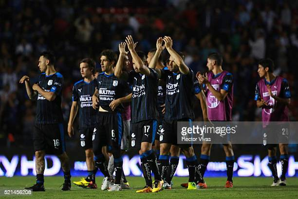 Players of Queretaro celebrate their victory after the 14th round match between Queretaro and America as part of the Clausura 2016 Liga MX at La...