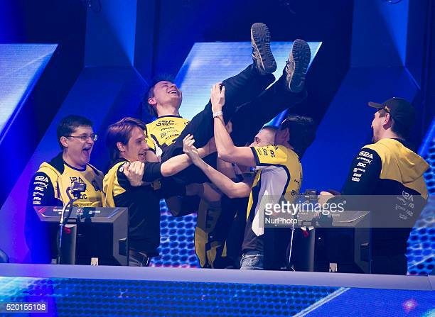 Players of quotNatus Vincerequot team celebrate the victory in the game World of Tanks in Warsaw 09 April Poland