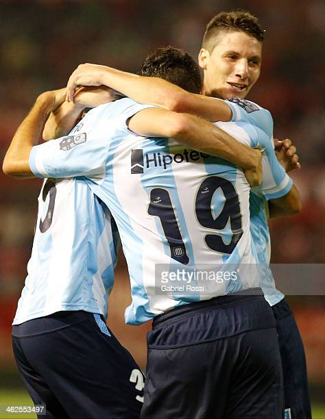 Players of Racing Club celebrate the third goal of their team scored by Valentin Viola during a match between Racing Club and Independiente as part...