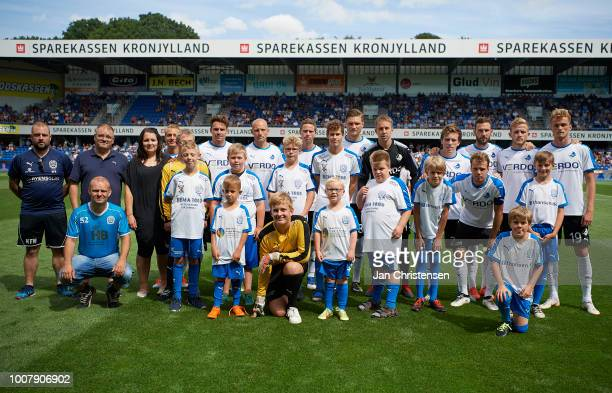 Players of Randers FC and mascots prior to the Danish Superliga match between Randers FC and OB Odense at BioNutria Park Randers on July 29 2018 in...