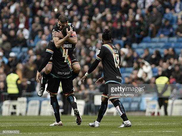 Players of Rayo Vallecano celebrate after scoring a goal during the La Liga match between Real Madrid CF and Rayo Vallecano at Estadio Santiago...
