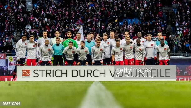 Players of RB Leipzig and Bayern Muenchen pose with special jerseys prior to the Bundesliga match between RB Leipzig and FC Bayern Muenchen at Red...