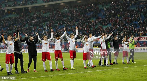 Players of RB Leipzig celebrate after winning the Bundesliga match between RB Leipzig and Hertha BSC at Red Bull Arena on December 17 2016 in Leipzig...