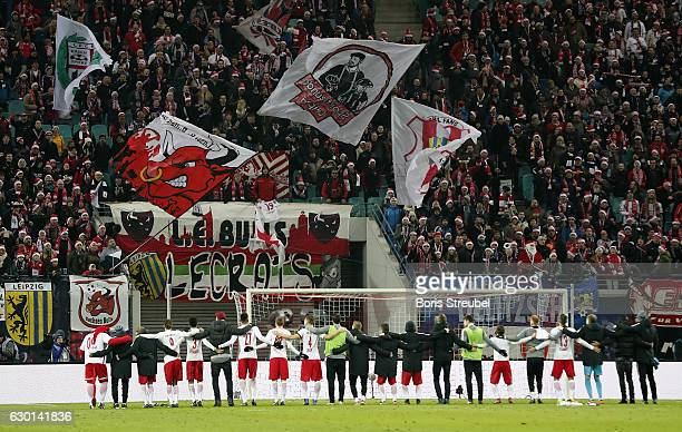 Players of RB Leipzig celebrate with their fans after winning the Bundesliga match between RB Leipzig and Hertha BSC at Red Bull Arena on December 17...