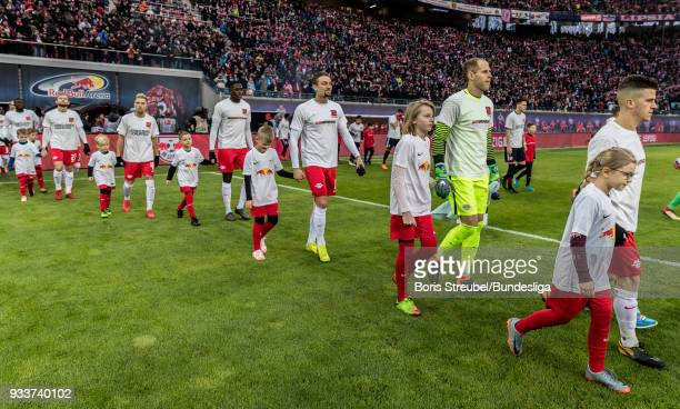 Players of RB Leipzig enter the pitch with special jerseys prior to the Bundesliga match between RB Leipzig and FC Bayern Muenchen at Red Bull Arena...