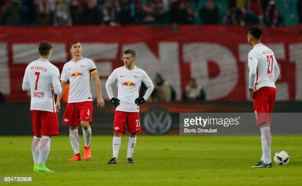 Players of RB Leipzig look dejected after losing the Bundesliga match between RB Leipzig and Hamburger SV at Red Bull Arena on February 11 2017 in...