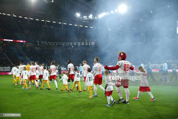 Players of RB Leipzig walk onto the pitch prior to the Bundesliga match between RB Leipzig and Borussia Moenchengladbach at Red Bull Arena on...
