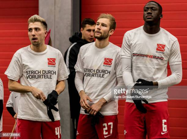 Players of RB Leipzig with special jerseys stand in the players tunnel prior to the Bundesliga match between RB Leipzig and FC Bayern Muenchen at Red...