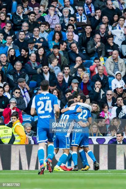 Players of RC Deportivo La Coruna celebrates teammate Adrian Lopez Alvarez's goal during the La Liga 201718 match between Real Madrid and RC...